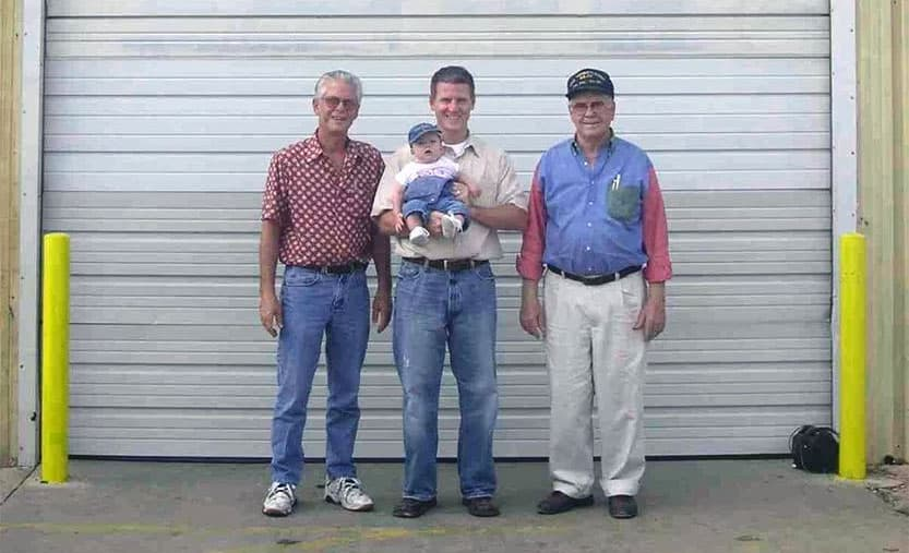 Four Generations of the South Family seen in front of Rustic Fence