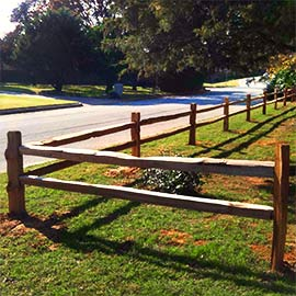 Split rail fence marks the border of a ranch