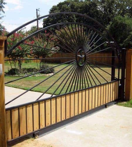 Stunning Ornamental Iron Work Beautifies A Steel And Wooden Slide Gate