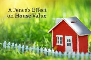 "A small toy house with a toy fence sits in real grass with the words ""A Fence's Effect on Home Value"""